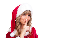 Young Christmas Woman is doing shh. Young woman, dressed in a Christmas costume is doing shh Royalty Free Stock Photo