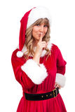 Young Christmas Woman is doing shh. Young woman, dressed in a Christmas costume is doing shh Royalty Free Stock Photos