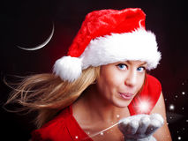 Young christmas woman holding star over dark royalty free stock photo