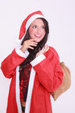 Young christmas woman in lingerie with jacket and red cap Royalty Free Stock Image