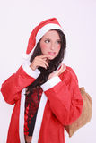 Young christmas woman in lingerie with jacket and red cap Royalty Free Stock Photo