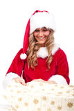 Young Christmas Woman is opening an xmas present Royalty Free Stock Photo