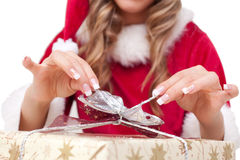 Young Christmas Woman is opening an xmas presents Royalty Free Stock Photo