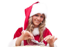 Young Christmas Woman is opening an xmas presents Royalty Free Stock Images