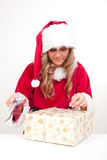 Young Christmas Woman is opening an xmas presents Stock Image