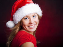 Young christmas woman over dark Royalty Free Stock Photos