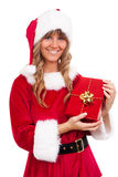 Young christmas woman with a present Stock Photos