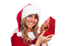 Young christmas woman with a present Stock Photography