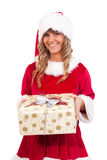 Young christmas woman with a present Royalty Free Stock Image