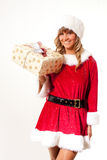 Young Christmas Woman with a present. Young woman, dressed in a Christmas costume. She is holding a present in her hands Royalty Free Stock Images