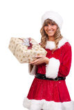 Young Christmas Woman with a present. Young woman, dressed in a Christmas costume. She is holding a present in her hands Royalty Free Stock Photography