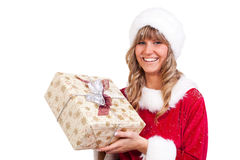 Young Christmas Woman with a present. Young woman, dressed in a Christmas costume. She is holding a present in her hands Royalty Free Stock Image