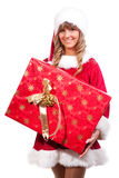 Young Christmas Woman with a present. Young woman, dressed in a Christmas costume. She is holding a present in her hands Stock Photos