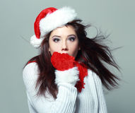 Young christmas woman. Christmas santa woman surprised. Beautiful face of happy asian woman in santa hat Royalty Free Stock Images