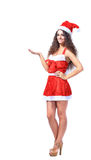 Young christmas woman show white Royalty Free Stock Image