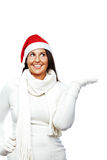 Young christmas woman showing copyspace Royalty Free Stock Images