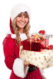 Young Christmas Woman with some present. Young woman, dressed in a Christmas costume. She is holding some xmas presents in her hands Stock Images