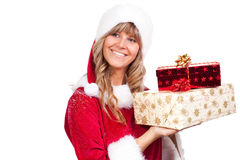 Young Christmas Woman with some presents. Young woman, dressed in a Christmas costume. She is holding some presents in her hands Stock Images