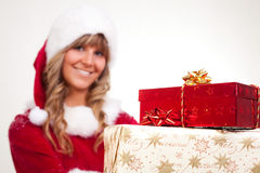 Young Christmas Woman with some presents Royalty Free Stock Photos