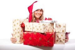Young Christmas Woman with some presents. Young woman, dressed in a Christmas costume. She is holding some presents in her hands Royalty Free Stock Images