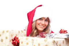 Young Christmas Woman with some presents. Young woman, dressed in a Christmas costume. She is holding some presents in her hands Royalty Free Stock Photo