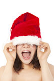 Young christmas woman using santa cap to cover eyes. Stock Image