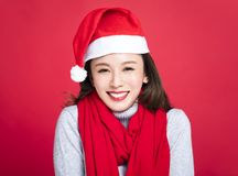 Christmas woman wearing santa hat and smiling. Young christmas woman wearing santa hat and smiling Royalty Free Stock Images