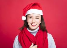 Christmas woman wearing santa hat and smiling. Young christmas woman wearing santa hat and smiling Royalty Free Stock Photography
