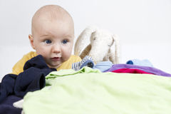 Young cild with washing and toy Royalty Free Stock Photo