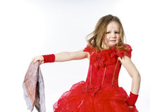 Young cinderella dressed in red with dirty cloth royalty free stock photo