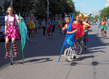 Young circus performers on cycles. Young circus performers on unicycles in the city street on the `Parade of street theatres` in Voronez Royalty Free Stock Photography