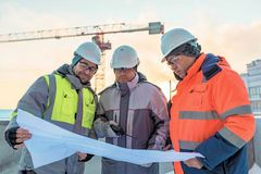 Young Civil Engineers and Senior Foreman At Construction Site stock photos