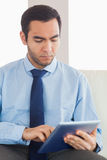Young classy businessman using tablet pc Stock Photo