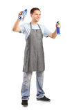 Young cleaner holding a cleaning supplies Stock Images