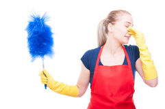 Young cleaning maid pinching her nose. Young female as a cleaning maid pinching her nose because of bad smell isolated on white background royalty free stock photography