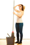 Young cleaning woman with mop and bucket Stock Photos