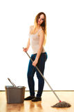 Young cleaning woman with mop and bucket Royalty Free Stock Photography