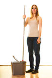 Young cleaning woman with mop and bucket Royalty Free Stock Photo