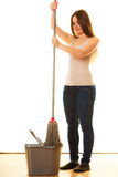 Young cleaning woman with mop and bucket Royalty Free Stock Photos