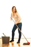 Young cleaning woman with mop and bucket Stock Photo