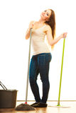 Young cleaning woman mopping floor. Cleanup housework concept. cleaning girl young woman mopping floor, holding two mops new and old white background Stock Photos