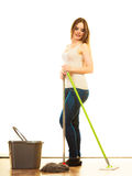 Young cleaning woman mopping floor. Cleanup housework concept. cleaning girl young woman mopping floor, holding two mops new and old white background Royalty Free Stock Photo