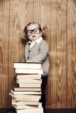 Young clever girl with books and glasses Stock Images
