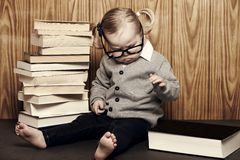 Young clever girl with books and glasses Stock Photography