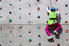 Young Climber. Youngster's effort in climbing a wall to reach the top Stock Photos