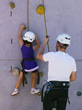 Young climber and father helping Stock Photography