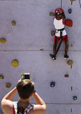 Young climber and mother picturing him Royalty Free Stock Images