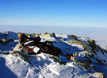 Young climber resting on top of Peleaga peak, Romania Royalty Free Stock Photography