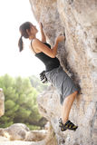 Young climber on stone wall Royalty Free Stock Photo