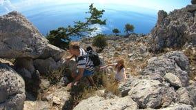 Young climbers rock climbing stock video